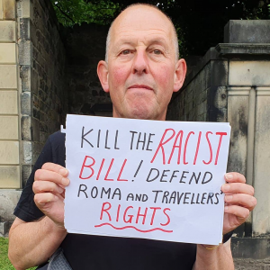 """Placard reads """"Kill the racist bill! Defend Roma and travellers' rights"""""""