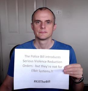 """Placard reads """"The Police Bill introduces Serious Violence Reduction Orders - but they're not for Elbit Systems?! #KillTheBill"""""""